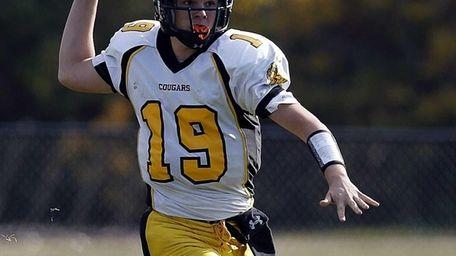 Commack quarterback Robert Paccione looks to pass against