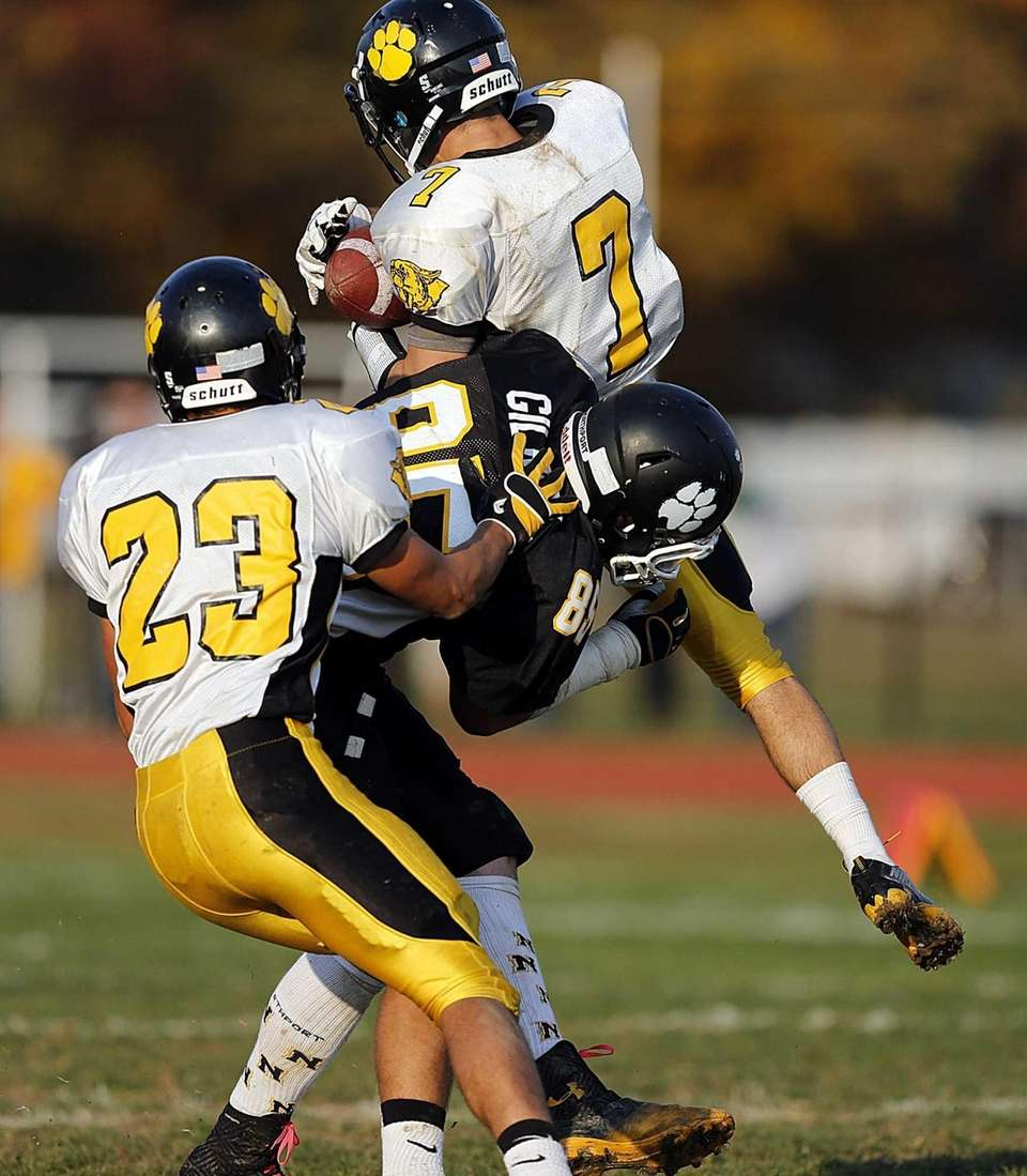 Commack defensive back Matt Recek (7) intercepts a
