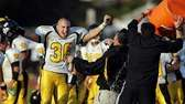 Commack's Andrew Caccamo (36) cheers as head coach
