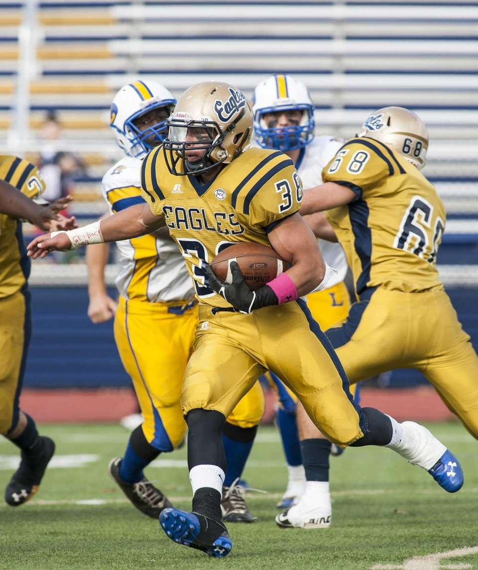 Bethpage's Yoannis Efstahiou (no. 38) rushes against Lawrence.