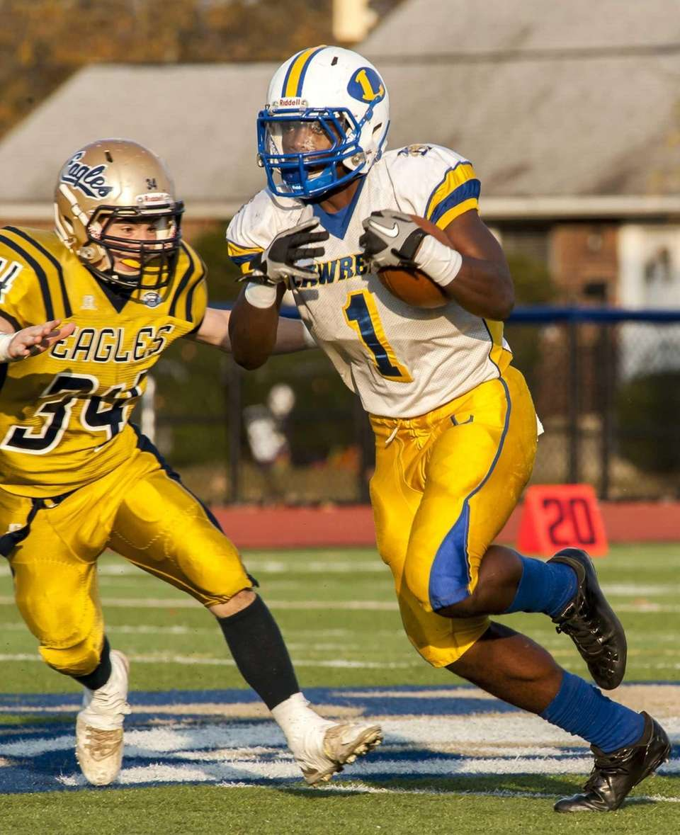 Lawrence's Jordan Fredericks (no. 1) tries to elude