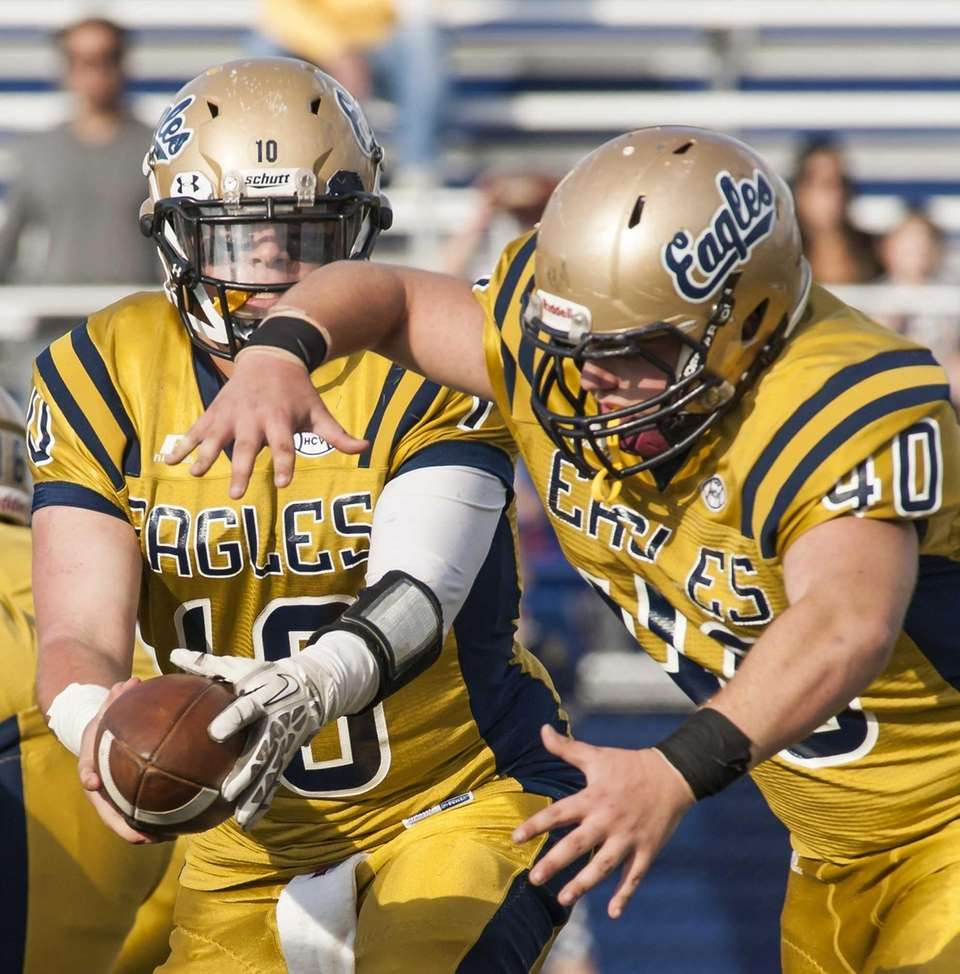 Bethpage's quarterback Christian Ferruzza (no. 10) hands the