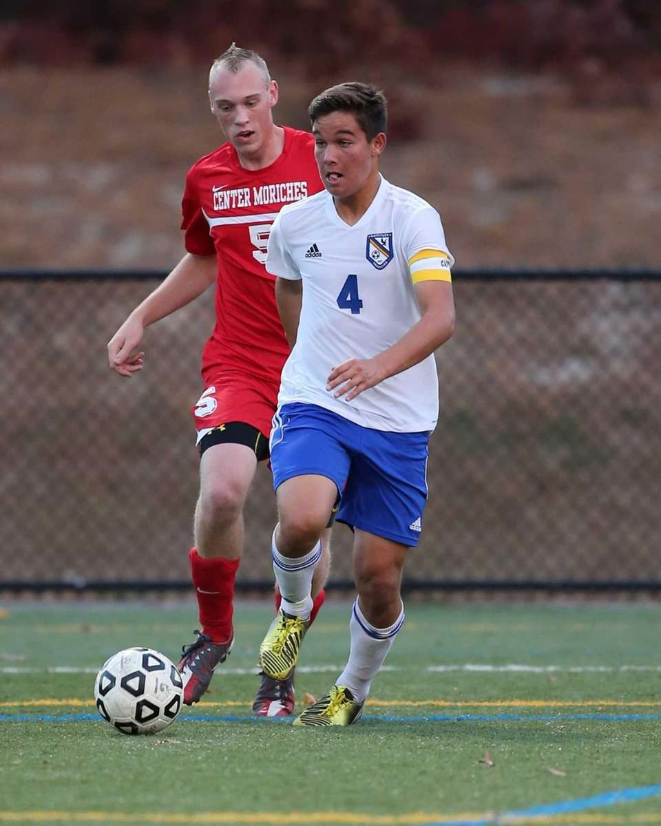 Mattituck's James Hayes (no. 4) moves past Center
