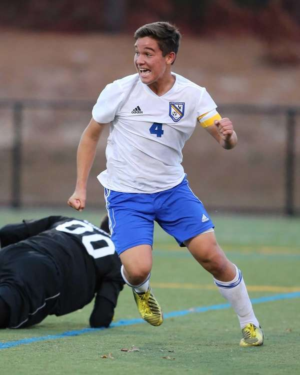Mattituck's James Hayes celebrates Kevin Williams' goal in