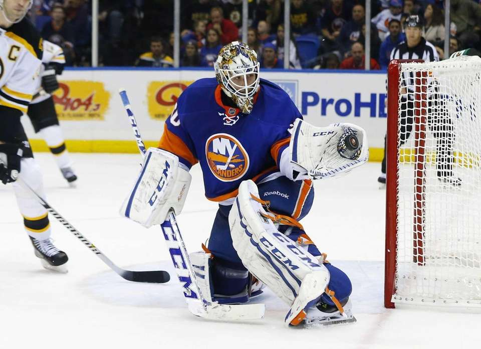 Islanders goaltender Kevin Poulin makes a second-period glove