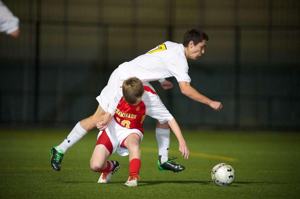 St. Anthony's midfielder John Foley (17) collides with