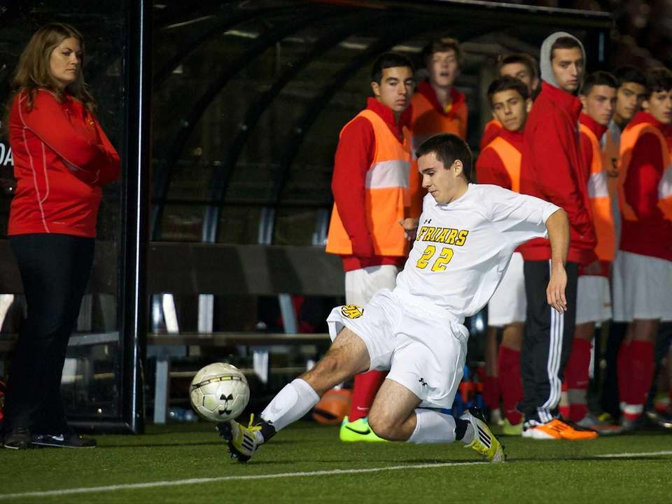 St. Anthony's defender Ryan Healy dives to prevent