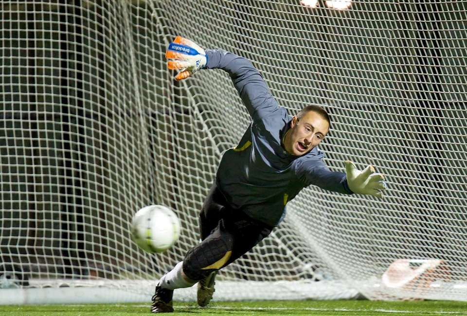St. Anthony's goalkeeper Joshua Weiss attempts a diving