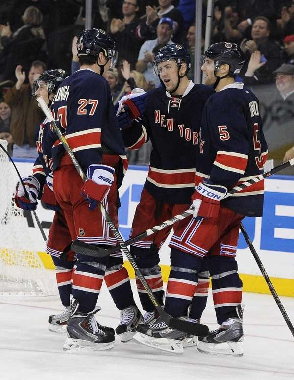 Rangers' Ryan McDonagh, left, and Dan Girardi, right,