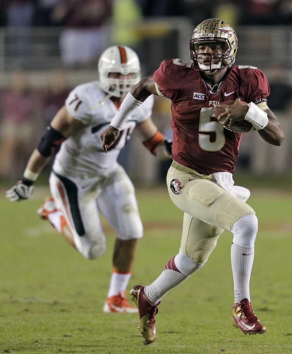 Florida State quarterback Jameis Winston (5) outruns Miami