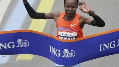 Priscah Jeptoo of Kenya crosses the finish line