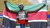 Geoffrey Mutai of Kenya holds the Kenyan flag
