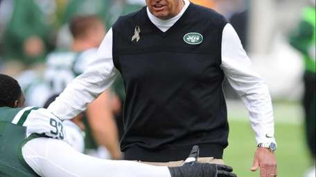 Rex Ryan gives a player a high-five before