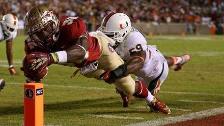 Florida State's James Wilder Jr. dives for a