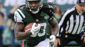 Chris Ivory (33) rushes during the first half