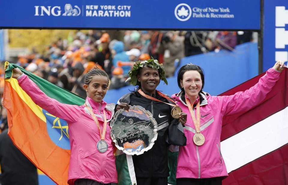 Women's marathon winner Priscah Jeptoo, of Kenya, center,