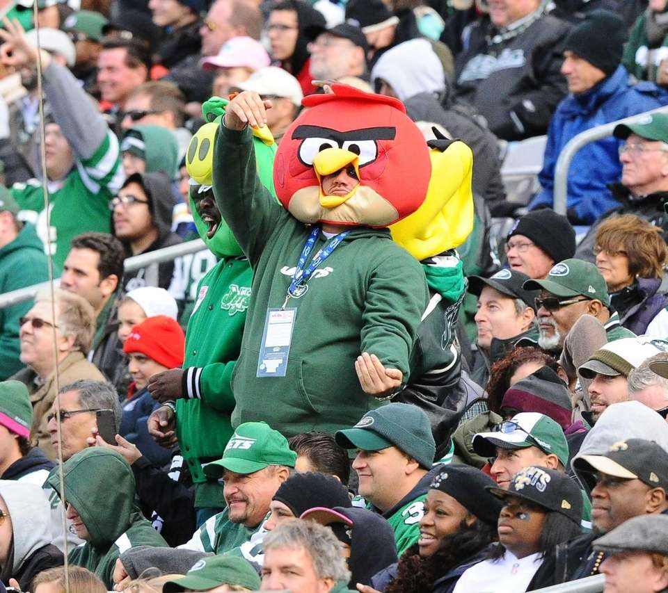 Jets fans look on during the first half
