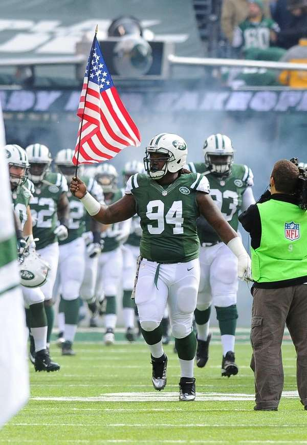 Damon Harrison leads the Jets onto the field