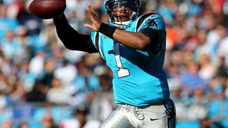 Carolina Panthers quarterback Cam Newton looks to pass