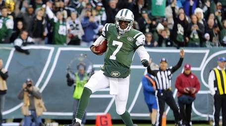 Geno Smith runs in a touchdown during the