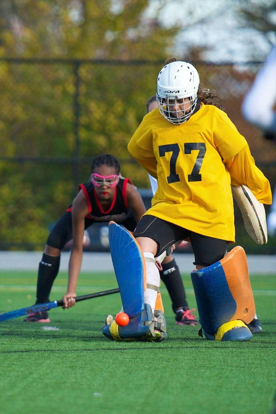 Carle Place goalie Lydia Rice (77) kicks a