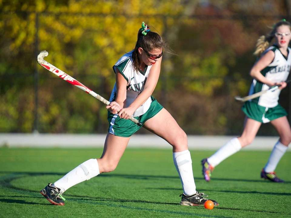 Carle Place's Shannon McGuinness (23) takes a shot