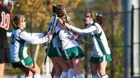 Carle Place's Elissa Frein is congratulated by her