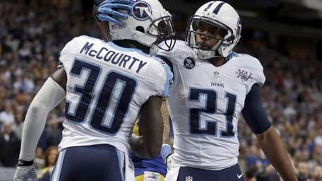 Tennessee Titans safety George Wilson celebrates with cornerback