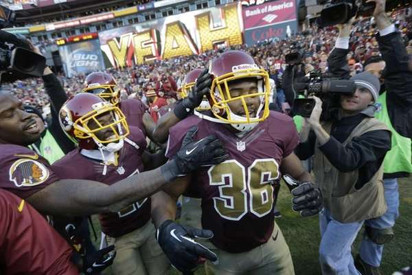 Washington Redskins fullback Darrel Young is congratulated by