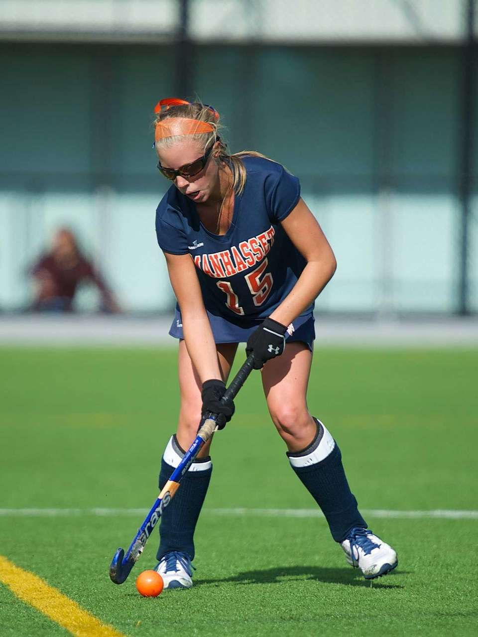 Manhasset midfielder Caitlyn Kenny (15) looks to pass