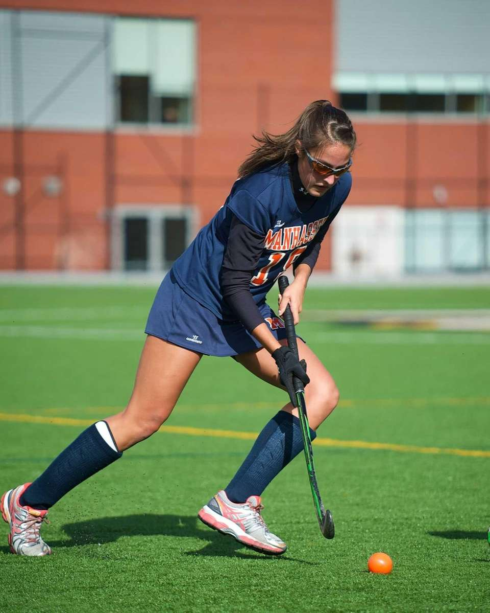 Manhasset midfielder Emily Koufakis (19) handles the ball