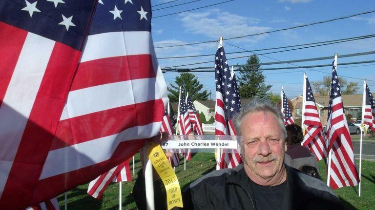 U.S. Army veteran John Wendel, of Farmingdale, stands
