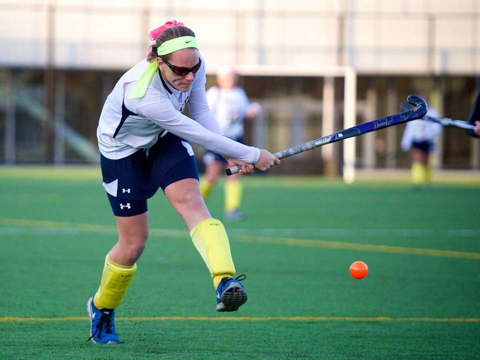 GMassapequa forward Jamie Ahrens (6) sends a ball