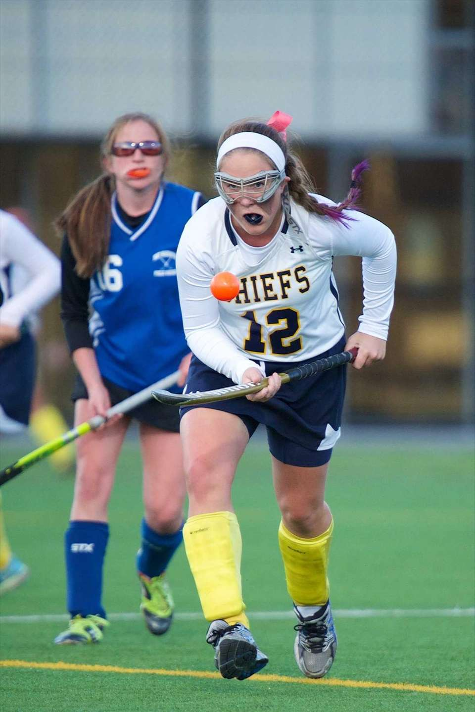Massapequa defender Colleen Bourgal (12) carries the ball