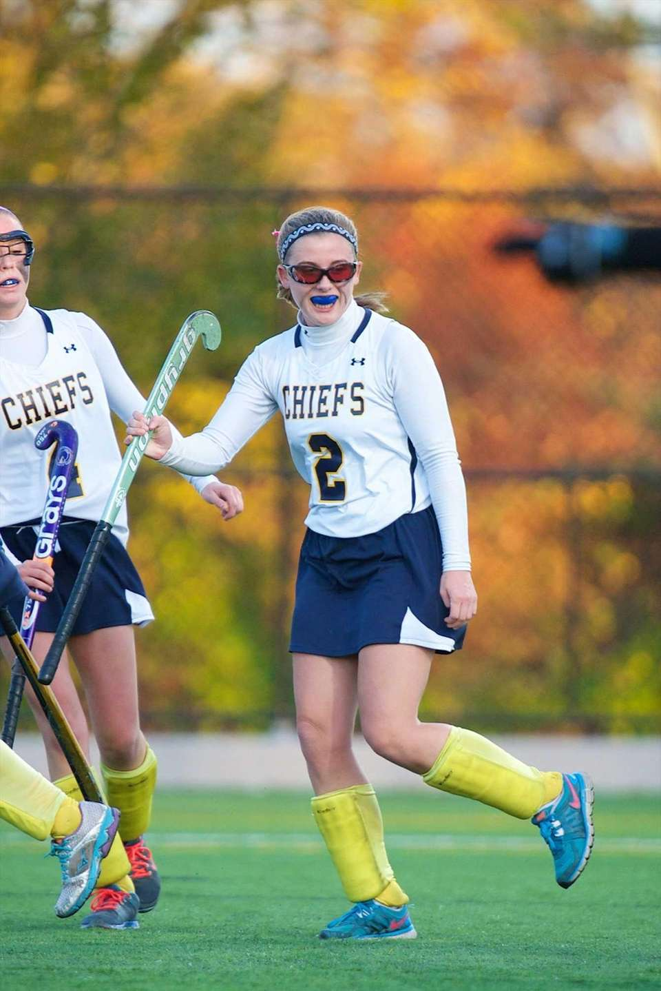 Massapequa forward Michele Cook (2) smiles after scoring