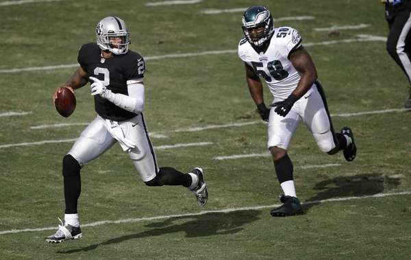 Oakland Raiders quarterback Terrelle Pryor runs away from