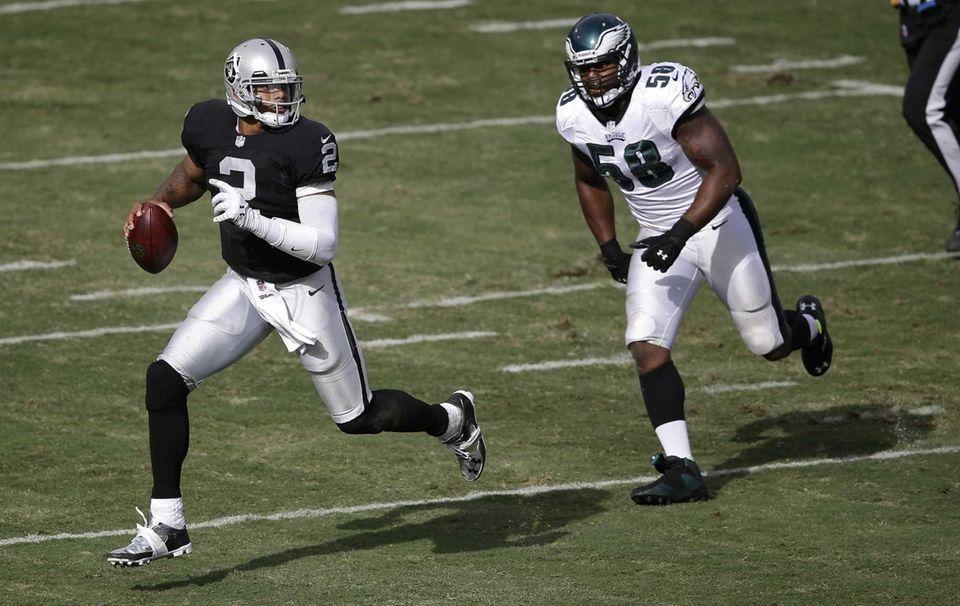 Oakland Raiders quarterback Terrelle Pryor runs away from