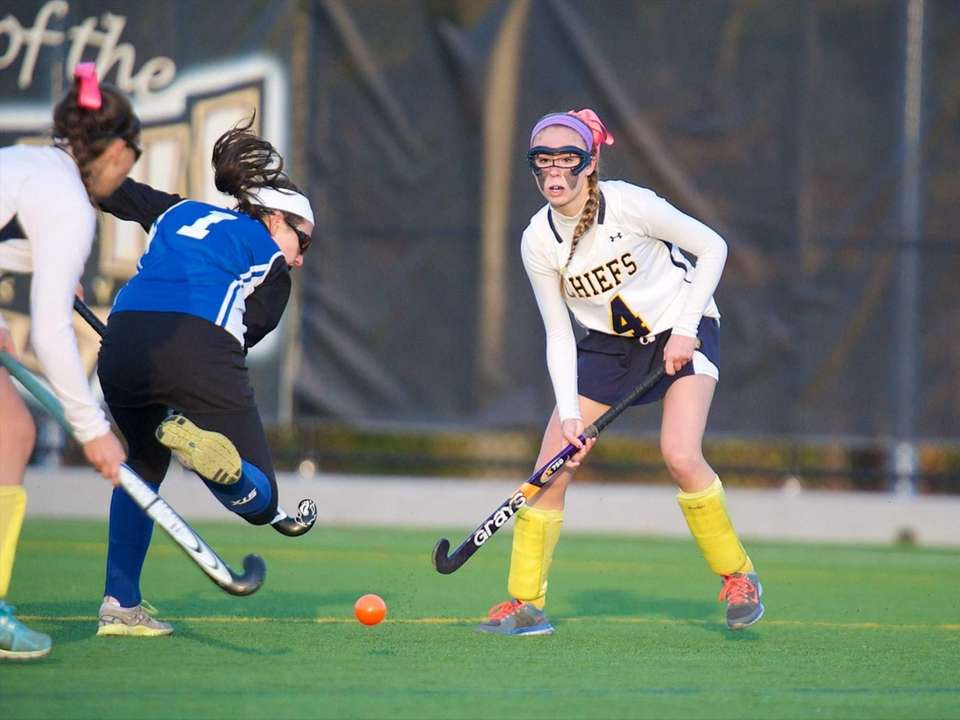Massapequa midfielder Kerri Sayrafe (4) passes the ball