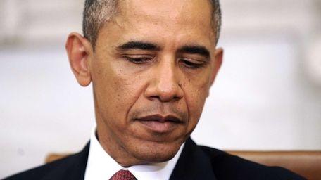 U.S. President Barack Obama looks on during a