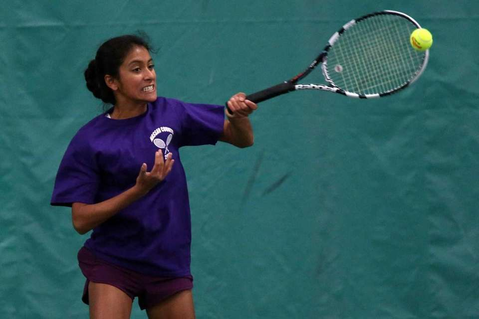 Herricks Taylor Cosme returns a serve during the