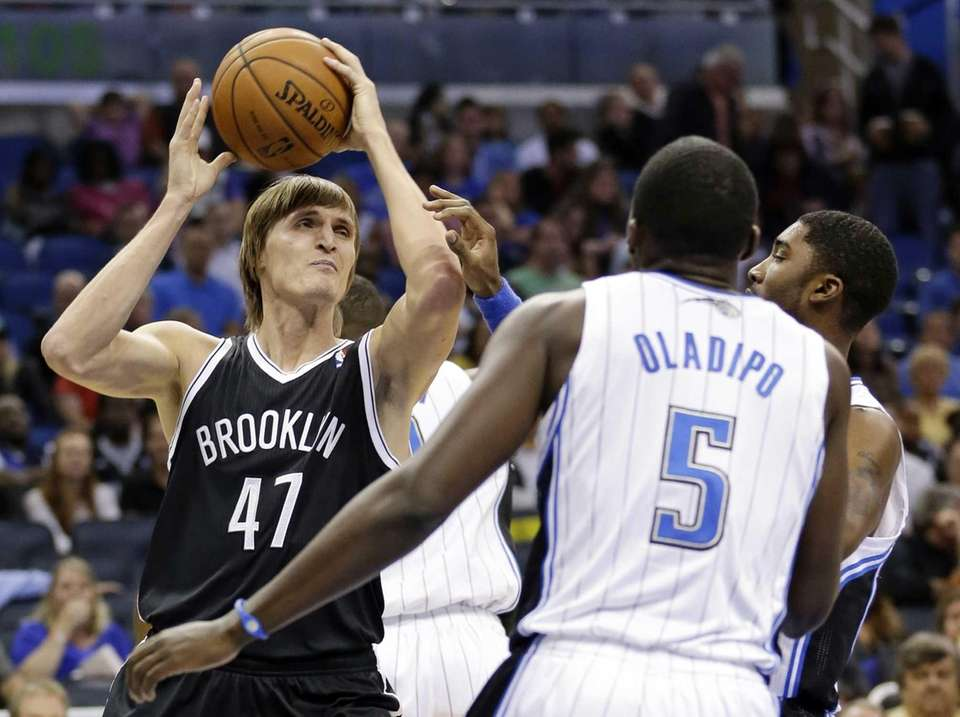 The Nets' Andrei Kirilenko (47) looks to pass