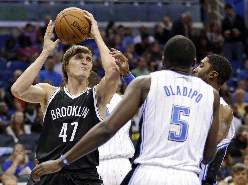 The Nets' Andrei Kirilenko (47) looks to pass