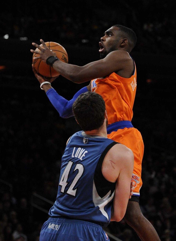 Knicks forward Tim Hardaway Jr. shoots over Minnesota