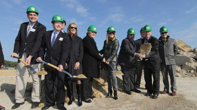 Local politicians and developers participate in a groundbreaking