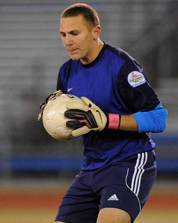 Massapequa goalie Dan Vitiello secures a ball during
