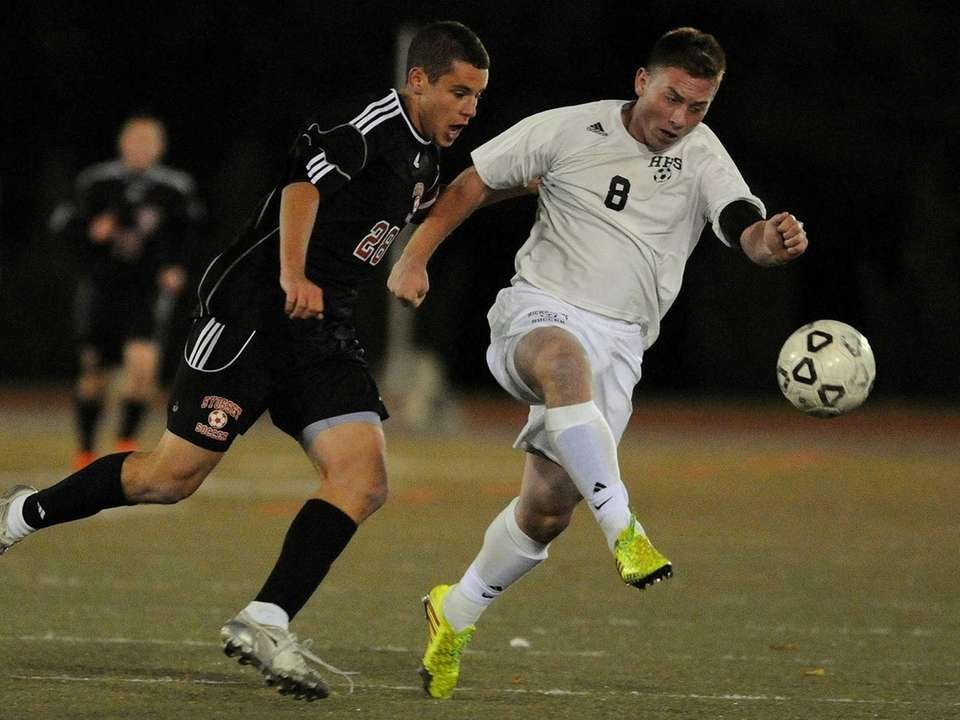 Hicksville's T.J. Kilmetis, right, gets pressured by Syosset's