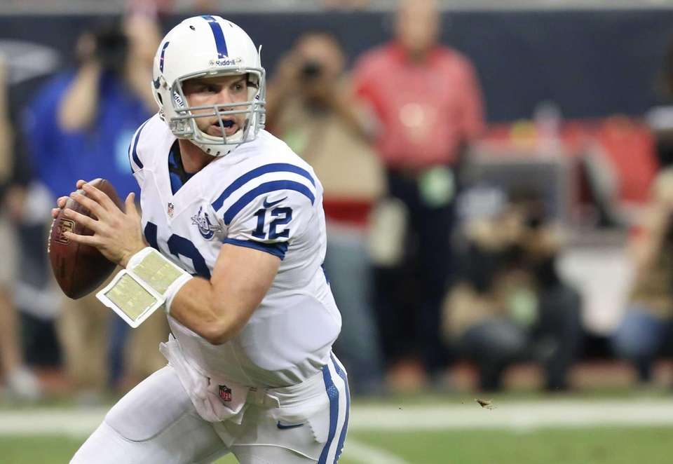 Indianapolis Colts quarterback Andrew Luck scrambles against the