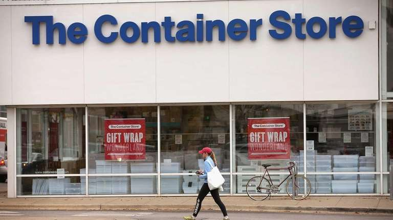 A customer leaves after shopping at The Container