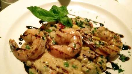 Shrimp-and-chorizo risotto is an appetizer at Eric's Italian