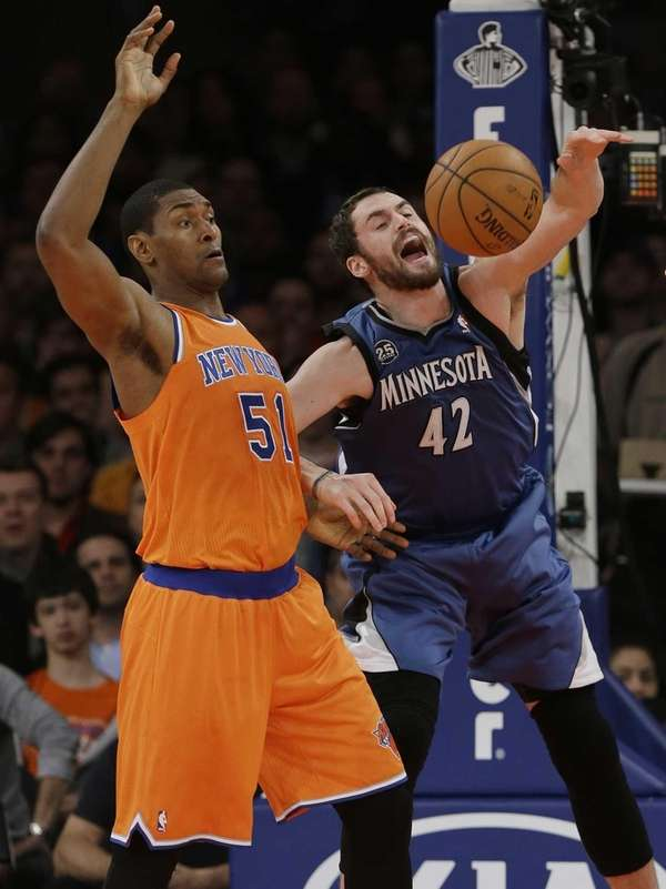 Minnesota's Kevin Love fights for control of the